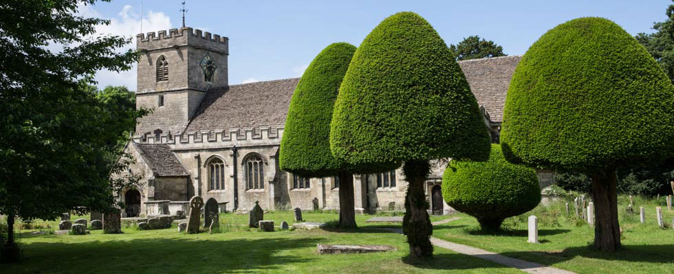 St George's Church Kings Stanley Gloucestershire with Yew Trees